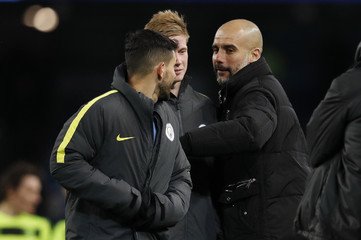Manchester City manager Pep Guardiola with Kevin De Bruyne and Sergio Aguero after the match