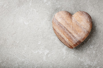 Stone heart on gray background