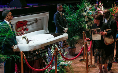 Chuck Berry lies in repose in an open casket as fans pay their respects to the late rock 'n' roll visionary at The Pageant club in St. Louis