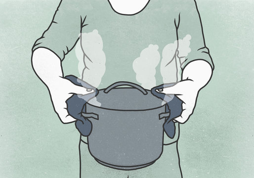 Midsection of woman holding cooking pot against colored background