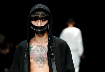 A model presents creation of ACUOD by CHANU from their Autumn/Winter 2017 collection during Tokyo Fashion Week in Tokyo