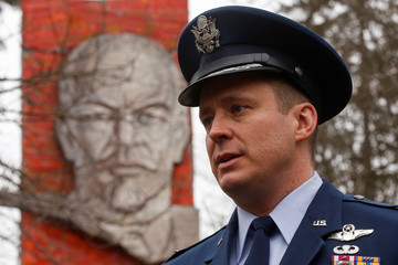 International Space Station (ISS) crew member U.S. astronaut Jack Fischer poses in front of the stele to Soviet Union founder Vladimir Lenin during a traditional farewell ceremony in Star City outside Moscow