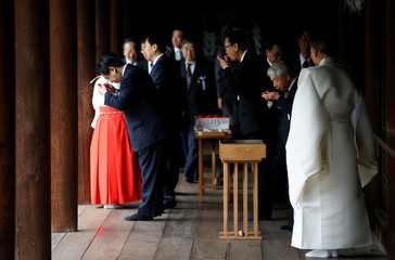 A group of lawmakers including Japan's ruling LDP lawmaker Otsuji sip sake as a ritual after offering prayers at the Yasukuni Shrine in Tokyo
