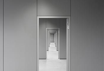 Empty corridor passing through doors