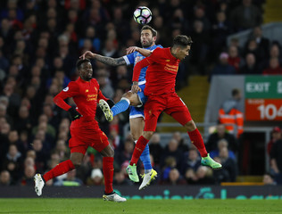 Bournemouth's Steve Cook in action with Liverpool's Roberto Firmino