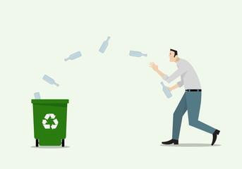Man Launching Bottles Into Recycle Bin