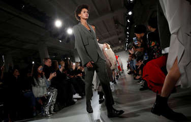 Models present creations at the Ports 1961 catwalk show during London Fashion Week in London