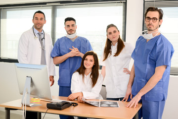 portrait of a medical team with nurse doctor and surgeon in hospital office wearing medical and operating room outfit