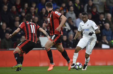 Swansea City's Jordan Ayew in action with Bournemouth's Charlie Daniels
