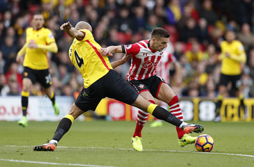 Watford's Younes Kaboul in action with Southampton's Dusan Tadic
