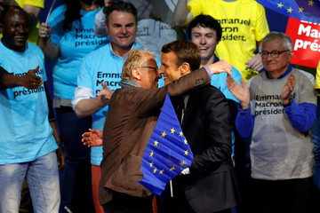 Former European Deputy Daniel Cohn-Bendit, and Emmanuel Macron, head of the political movement En Marche !, or Onwards !, and candidate for the 2017 presidential election, attend a campaign political rally in Saint-Herblain
