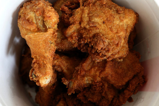A Kentucky Fried Chicken (KFC) bucket of fried chicken is seen in this picture illustration