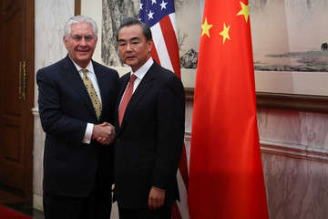 U.S. Secretary of State Rex Tillerson shakes hands with Chinese Foreign Minister Wang Yi, as he arrives for a bilateral meeting at the Diaoyutai State Guesthouse in Beijing