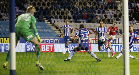 Barnsley's Ryan Kent scores their second goal