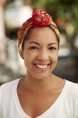 Portrait of smiling Black woman wearing headscarf