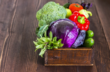 Fresh vegetables red cabbage and broccoli, cucumbers and peppers, tomatoes and basil