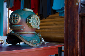 Patina Dive Helmet in Store Window Sitting on Red Table