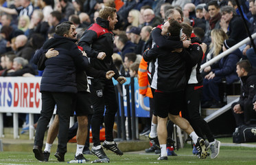 Bristol City Manager Lee Johnson celebrates with coaching staff after his sides second goal