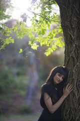 Portrait of young beautiful woman, model of fashion, in nature landscape.