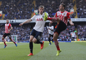 Tottenham's Eric Dier in action with Southampton's Dusan Tadic