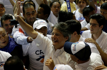 CREO party presidential candidate Guillermo Lasso greets supporters as he arrives at a closing campaign rally in Guayaquil
