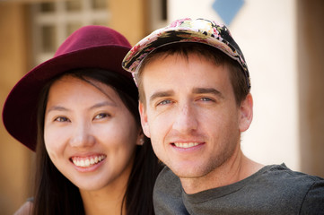 Portrait of smiling couple wearing hats