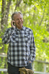 Caucasian man talking on cell phone outdoors