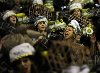 Revellers parade for the Gavioes da Fiel samba school during the carnival in Sao Paulo