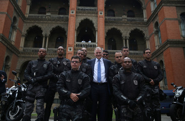 EU Commissioner for Health and Food Safety, Andriukaitis, poses for a photo with police officers during his visit in Oswaldo Cruz Foundation (Fiocruz) in Rio de Janeiro