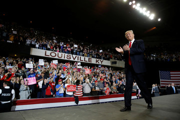 U.S. President Donald Trump takes the stage for a rally at the Kentucky Exposition Center in Louisville, Kentucky