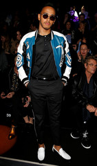Formula One driver Hamilton poses for a picture before attending the Dolce&Gabbana Autumn/Winter 2017 women collection during Milan's Fashion Week in Milan