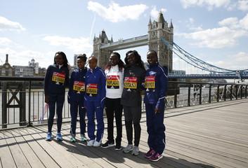 (L-R) Tirunesh Dibaba, Tigist Tufa, Mare Dibaba of Ethiopia and Florence Kiplagat, Mary Keitany and Vivian Cheruiyot of Kenya pose for a photo in front of Tower Bridge ahead of the 2017 Virgin Money London Marathon