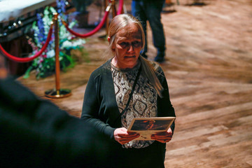 Fans pay their respects to the late rock 'n' roll visionary during his funeral at The Pageant club in St. Louis