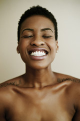 Portrait of smiling Black woman with eyes closed