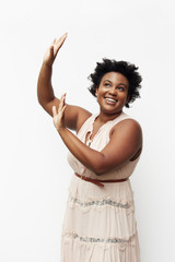 Portrait of smiling Black woman raising arms