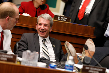 Rep. Kurt Schrader (D-OR) speaks to a colleague during a marathon House Energy and Commerce Committee hearing on a potential replacement for the Affordable Care Act
