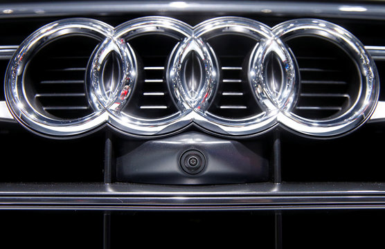 A lens of a camera system is placed under the logo of an Audi Q5 car during the 87th International Motor Show at Palexpo in Geneva