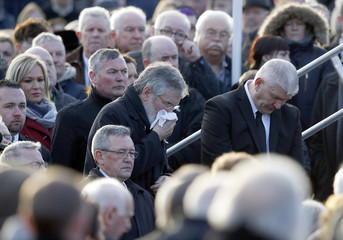 Sinn Feinn President Gerry Adams joins mourners for the funeral of Martin McGuinness in Londonderry