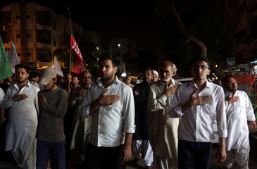 Shi'ite Muslim supporters of the Imamia Student Organization (ISO) beat their chests as they chant slogans condemning the blast in Parachinar, during a demonstration in Karachi