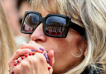 A woman attends as Pope Francis leads the weekly general audience in Saint Peter's Square at the Vatican