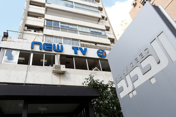Broken windows are pictured at the headquarters of Lebanese television channel al-Jadeed, after demonstrators attacked the channel's headquarters on Tuesday