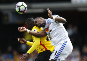 Watford's M'Baye Niang in action with Sunderland's Lamine Kone