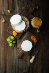 Soft camembert cheese with dried apricots and grapes