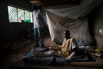 A man lies on a mattress at a shelter for displaced people in Bangui