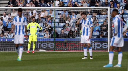 Huddersfield's Danny Ward looks dejected after Fulham's fourth goal