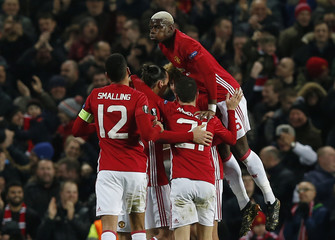 Manchester United's Zlatan Ibrahimovic celebrates scoring their first goal with Paul Pogba and teammates