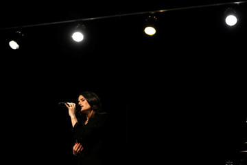 Recording artist Menzel rehearses ahead of her world tour in a recording studio in Burbank