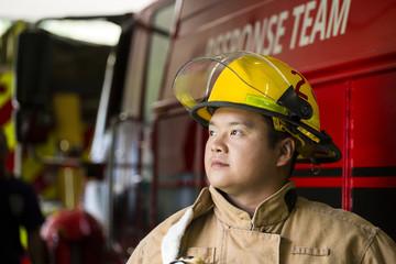 Chinese fireman standing near fire truck