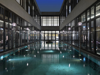 Reflection pool surrounded by modern glass building