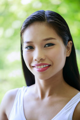 Portrait of smiling Asian teenage girl
